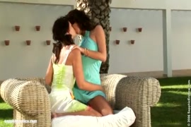 Sensual lesbian kiss with a beautiful woman in the garden.